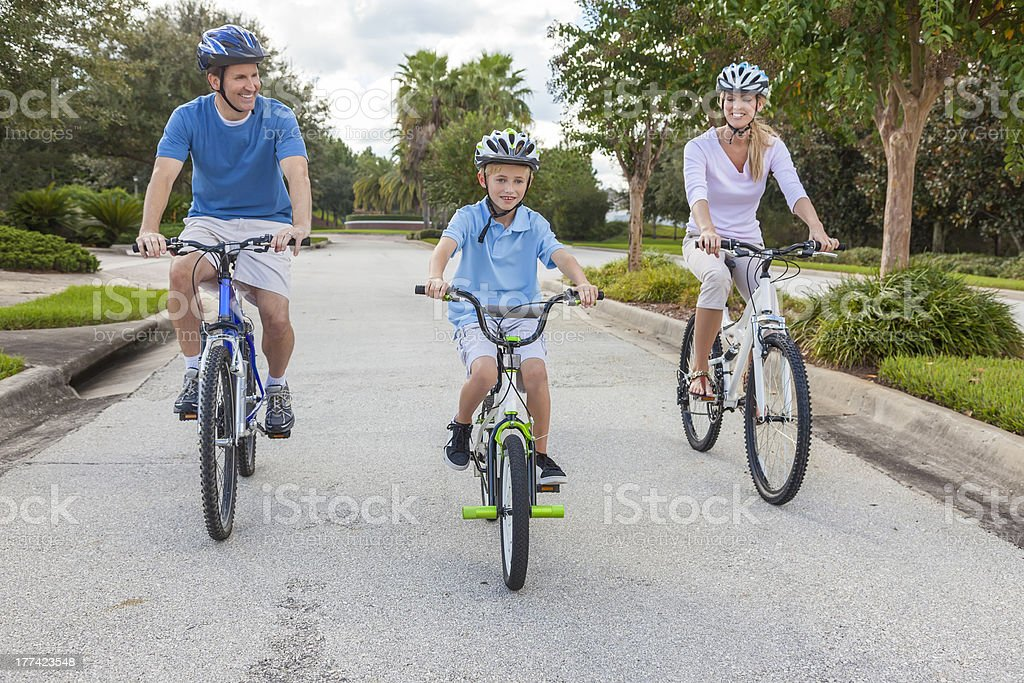 Young Family Parents and Boy Son Cycling stock photo