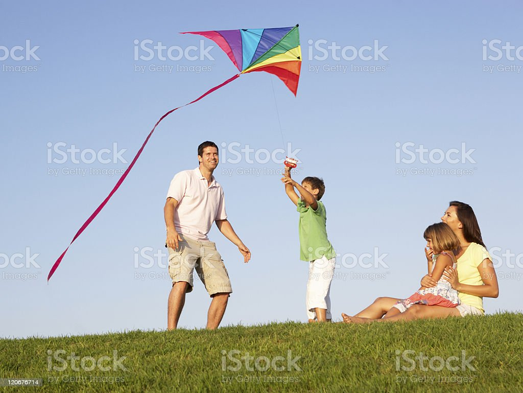 Young family playing in a field stock photo