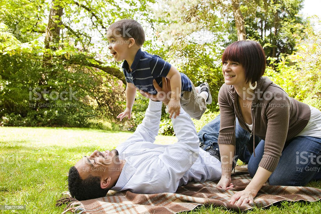 Young Family Playing in The Park royalty-free stock photo