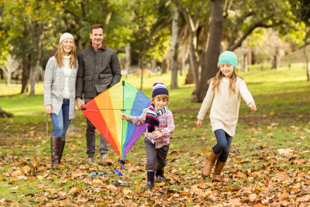 Young family playing with a kite stock photo