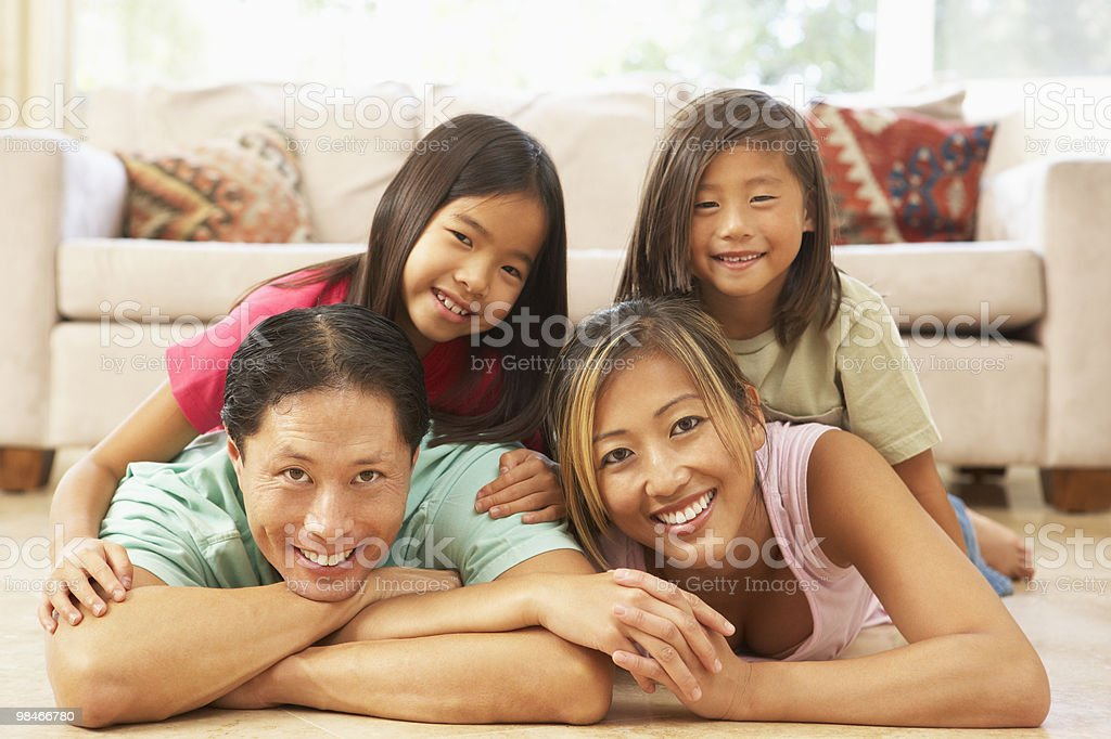 Young Family Relaxing At Home royalty-free stock photo