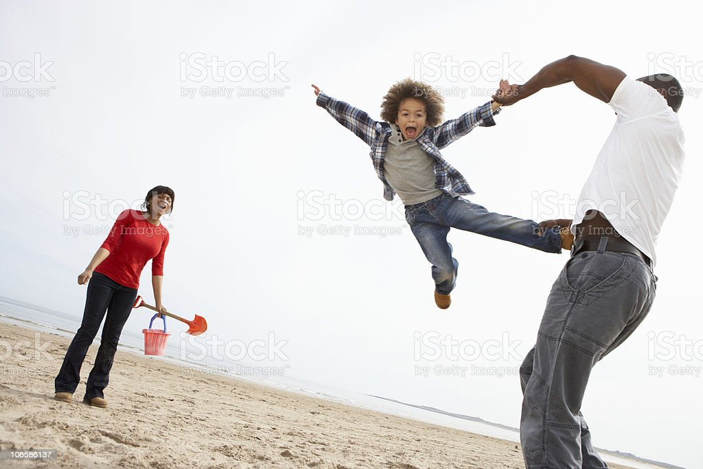 Young Family Relaxing On Beach Camping Holiday royalty-free stock photo