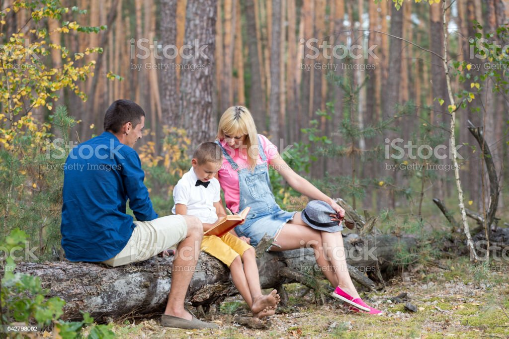 Young family relaxing on the nature. stock photo