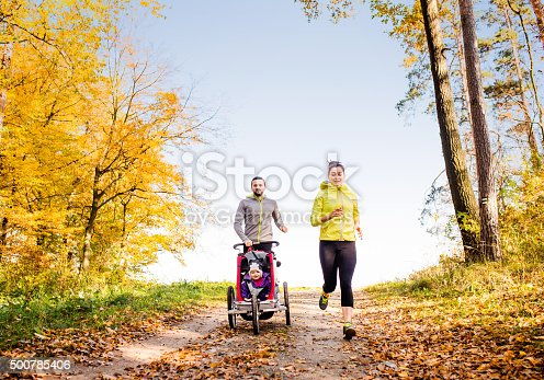 istock Young family running 500785406