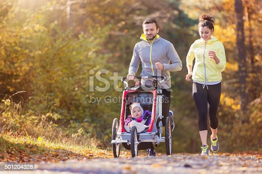 istock Young family running 501204328