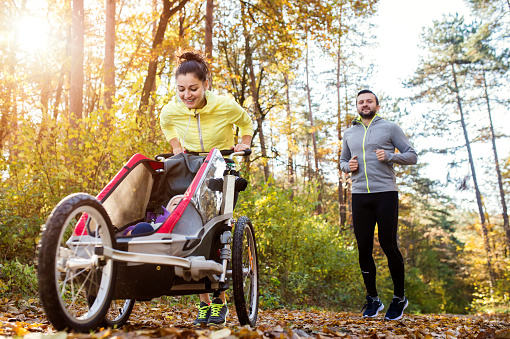 istock Young family running 507070788