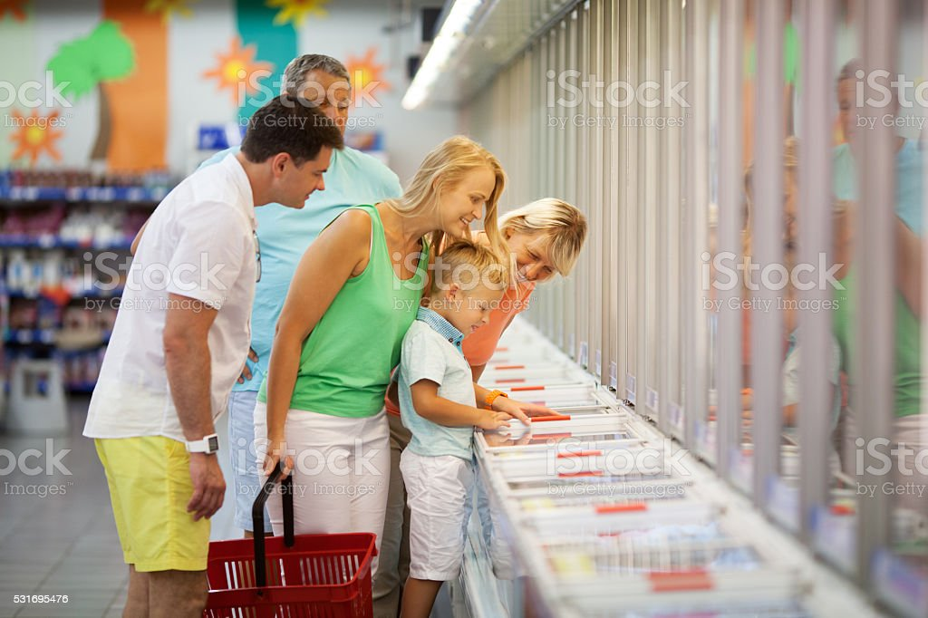 Young family shopping with the Grandparents stock photo