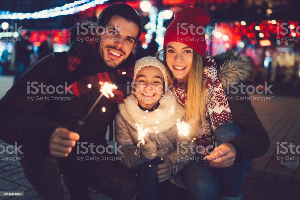 Young family spending Christmas outside stock photo
