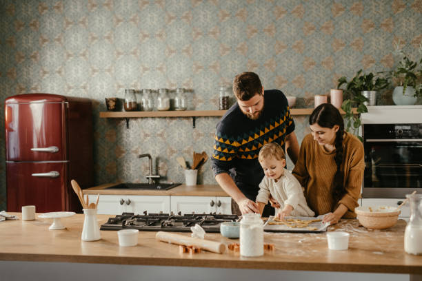 Young family spending time together at home stock photo