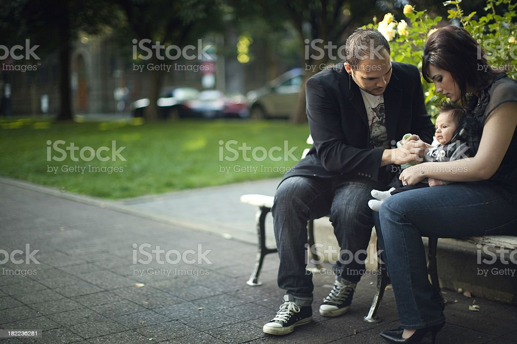 Young Family Taking Care of Baby royalty-free stock photo