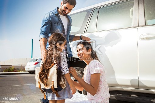istock Young family taking daughter to school by car 469138682