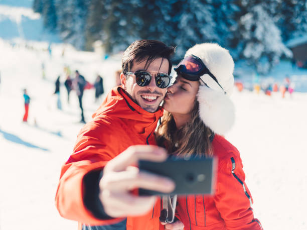 Young family taking selfie on the ski slope picture id1031014634?b=1&k=6&m=1031014634&s=612x612&w=0&h= 9y130ivgjwe37tljigxbiaouijaiylq9z2oubge7l8=