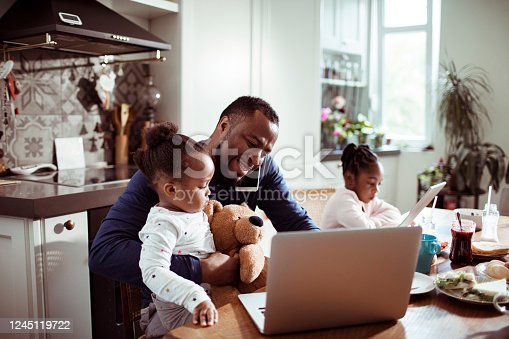istock Young Family using a Laptop during Breakfast 1245119722