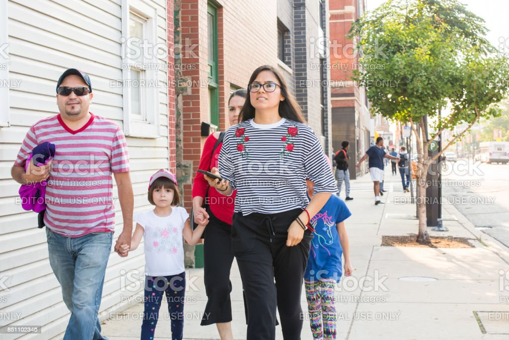 Young family walking in River West Chicago stock photo