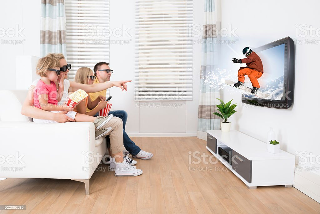 Young Family Watching 3D TV stock photo