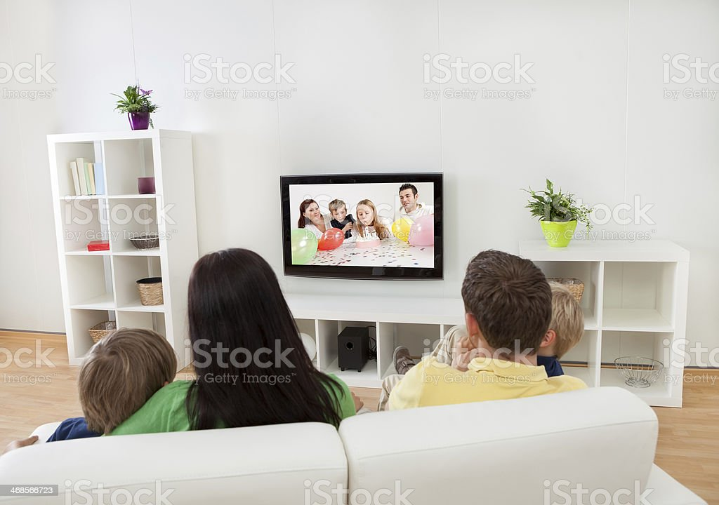 Young family watching TV stock photo