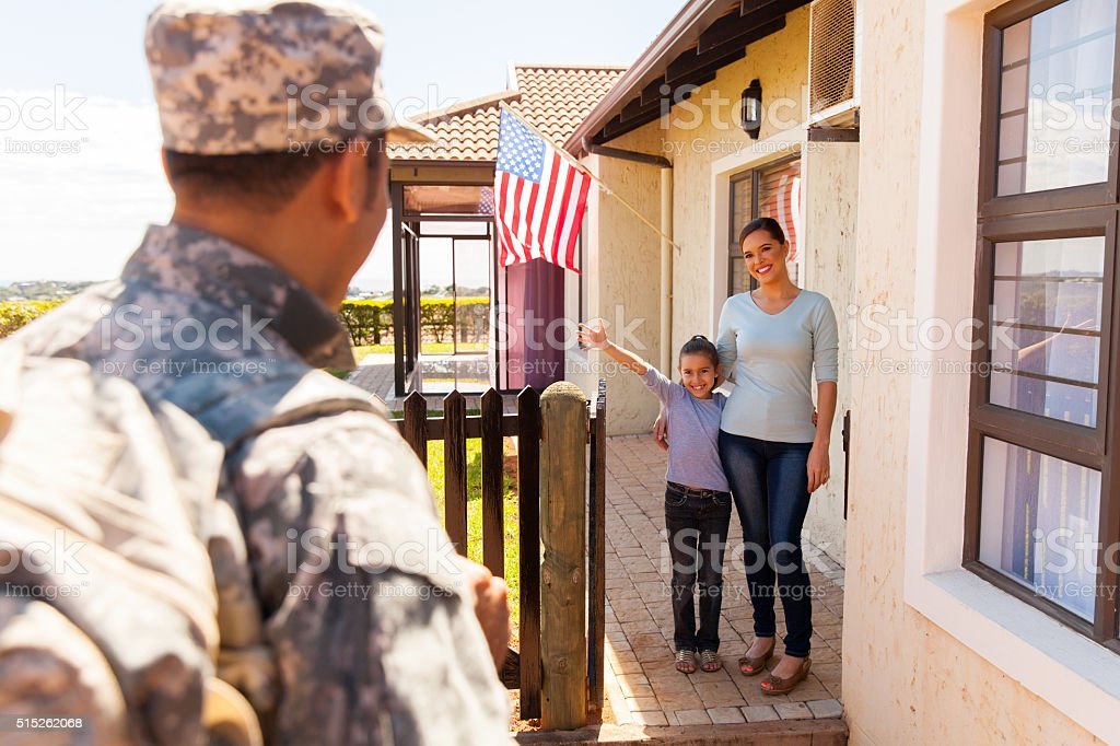 young family welcoming military father returning home stock photo