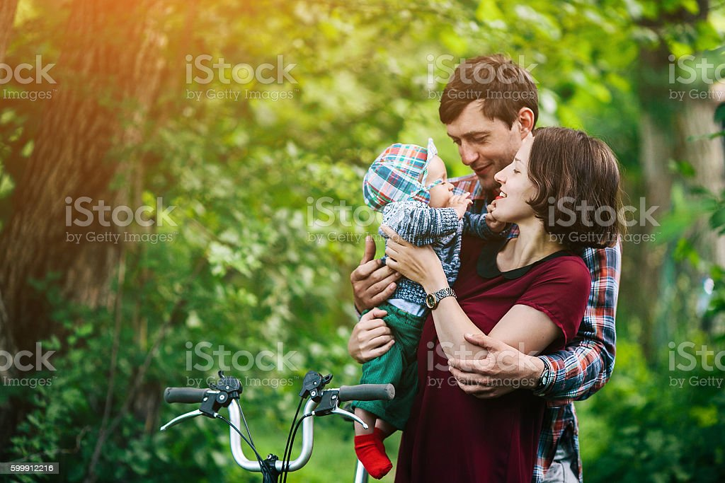young family with a child on the nature stock photo