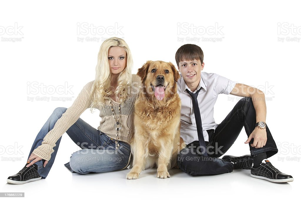 Young family with a dog sitting on floor royalty-free stock photo