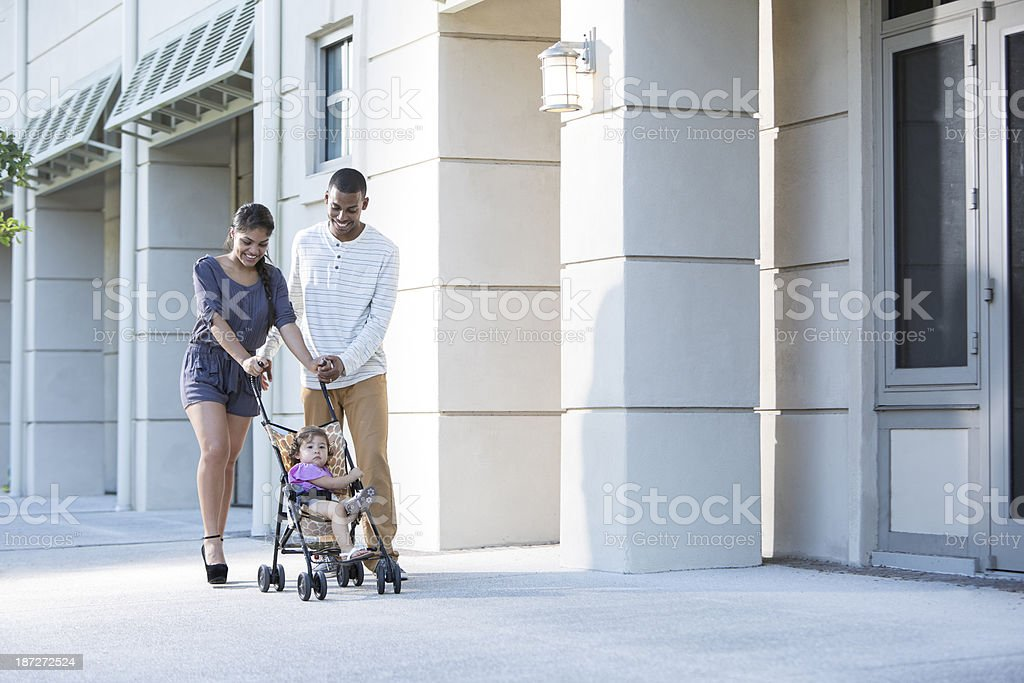 Young family with baby in stroller royalty-free stock photo
