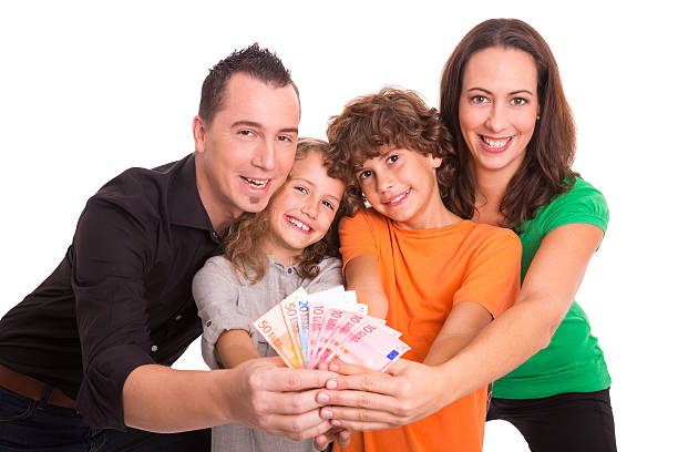Young family with money in their hands stock photo