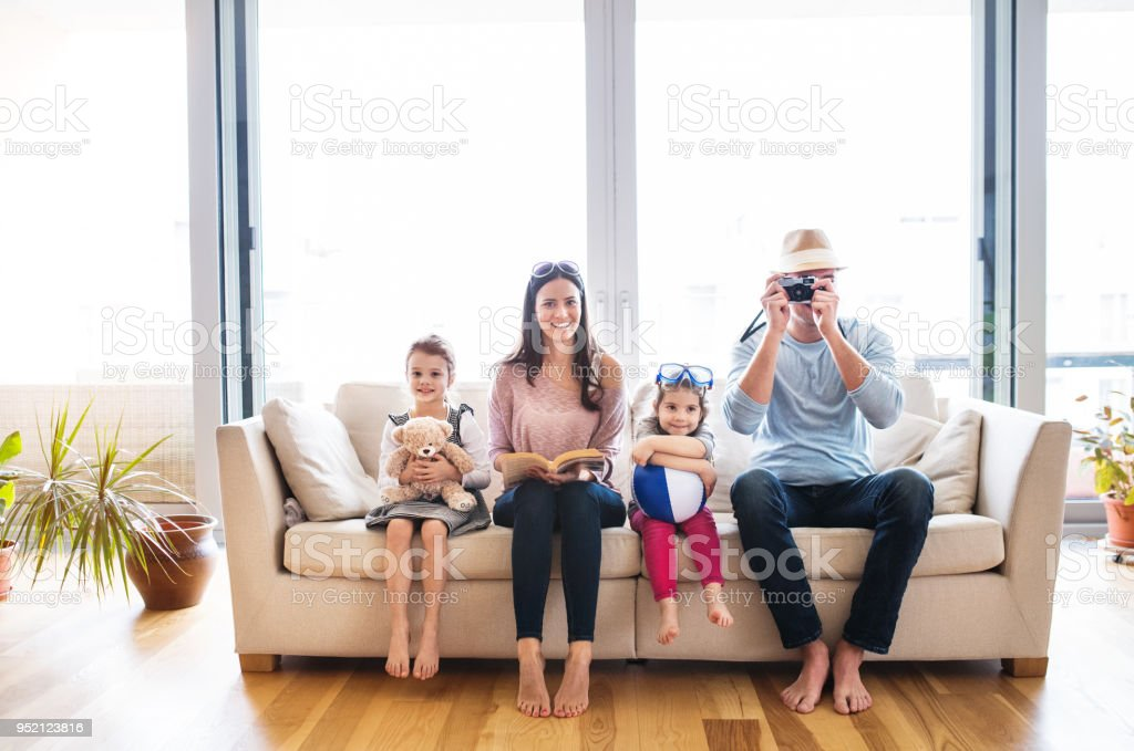 Young family with two children getting ready for holiday. stock photo