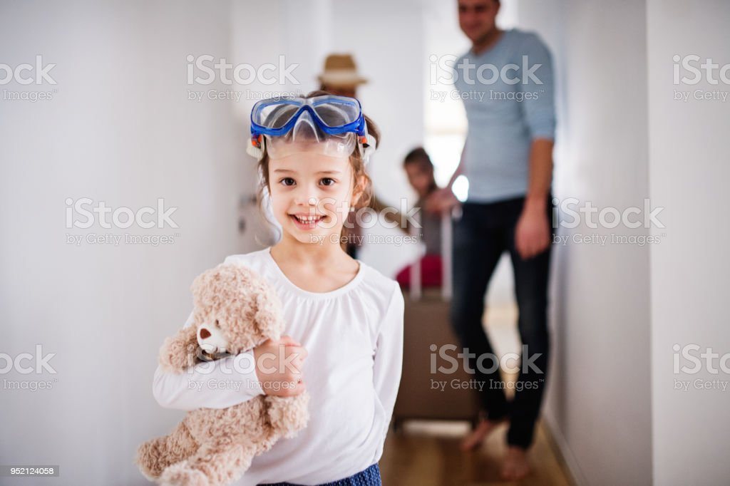 Young family with two children going on a holiday. stock photo