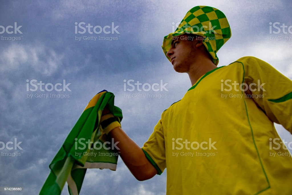 80fe81389ba Young Fan Of Brazil Celebrating With The Brazilian Flag Stock Photo ...