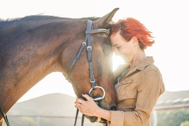 young farmer woman hugging her horse - concept about love between people and animals - focus on girl eye - horse stock pictures, royalty-free photos & images