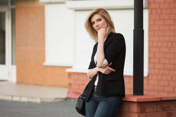 Young fashion blond business woman in black blazer