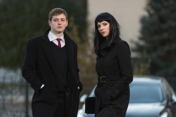 Young fashion business couple on city street