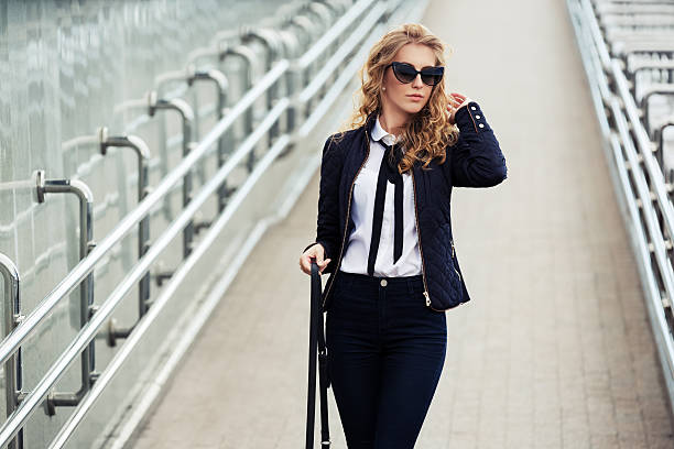Young fashion business woman walking on the city street