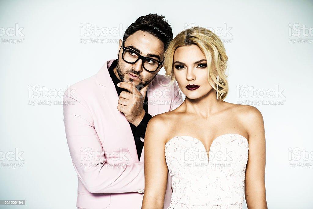 young fashion couple on a white background in studio Lizenzfreies stock-foto