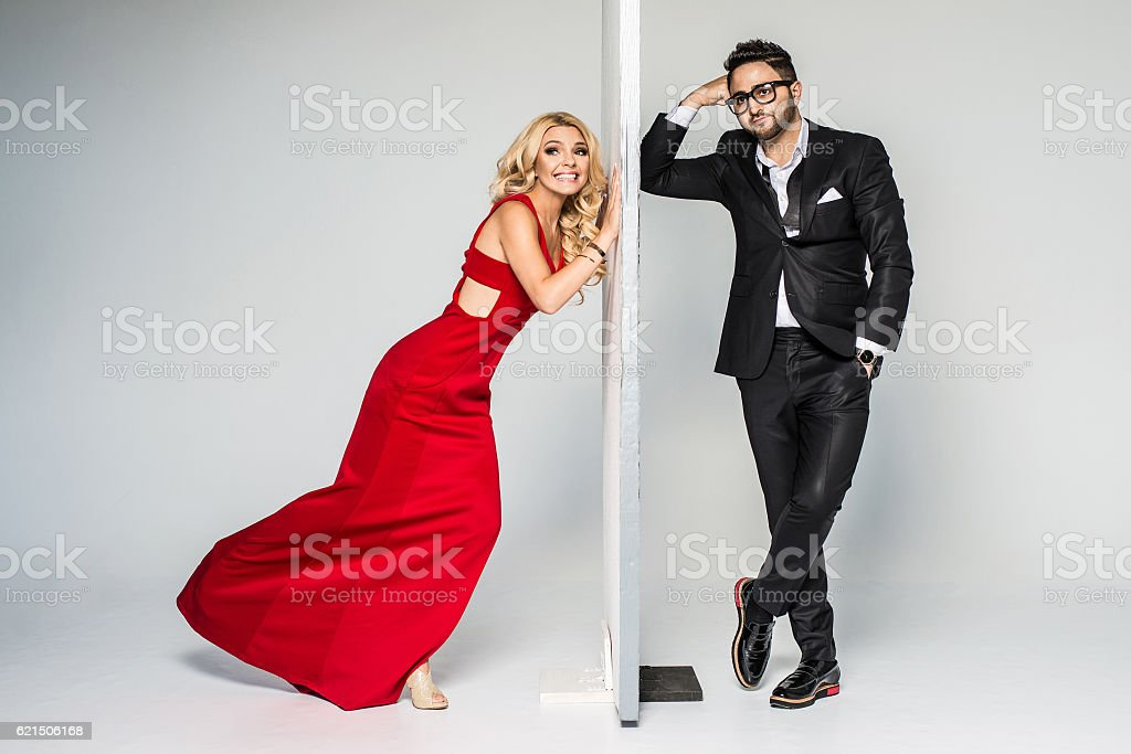 young fashion couple on a white background in studio Lizenzfreies stock-foto