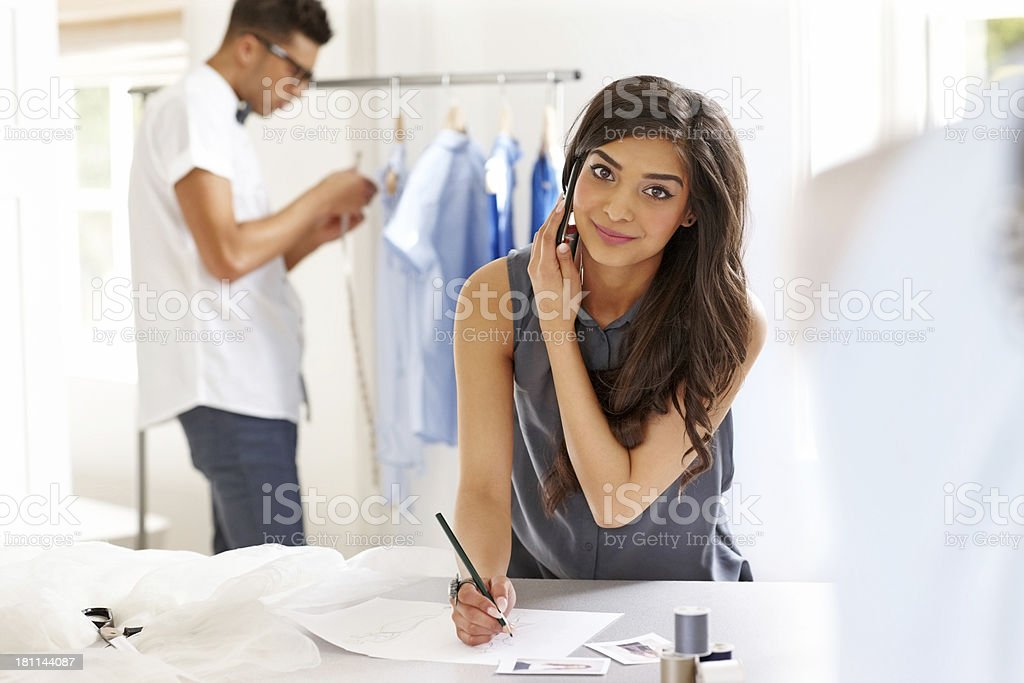Young fashion designer on the phone royalty-free stock photo