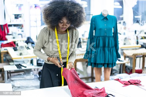 Young fashion designer working on her workplace