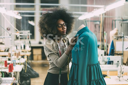Young fashion designer at her workplace