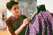 Young Fashion Designer Working In Her Workshop