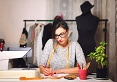 Young fashion designer sketching clothes