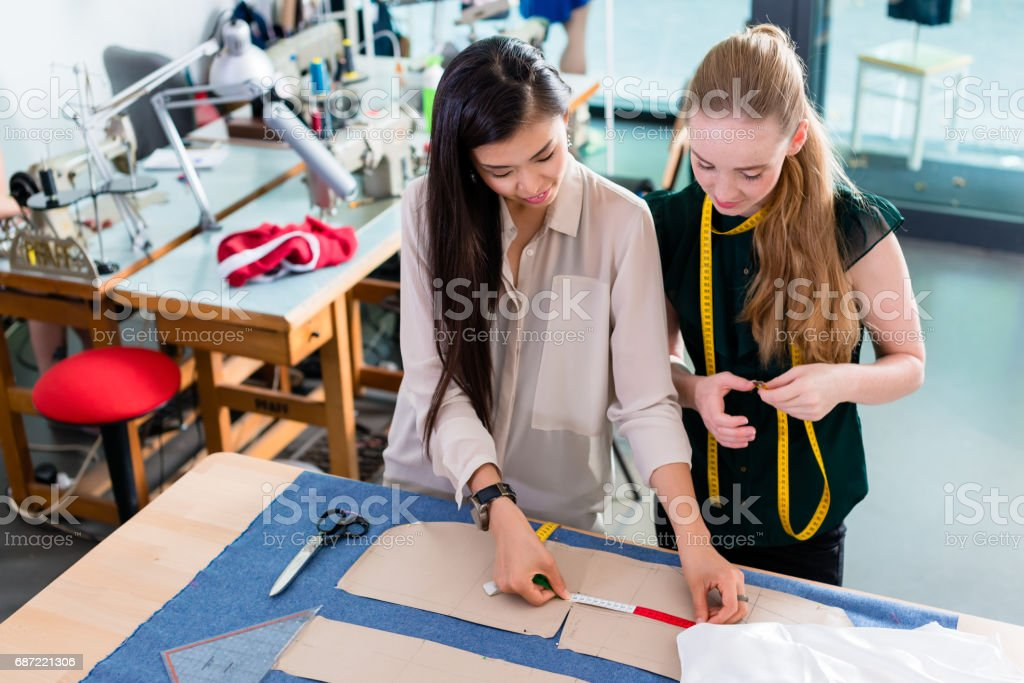 Young fashion designers talking about layout stock photo