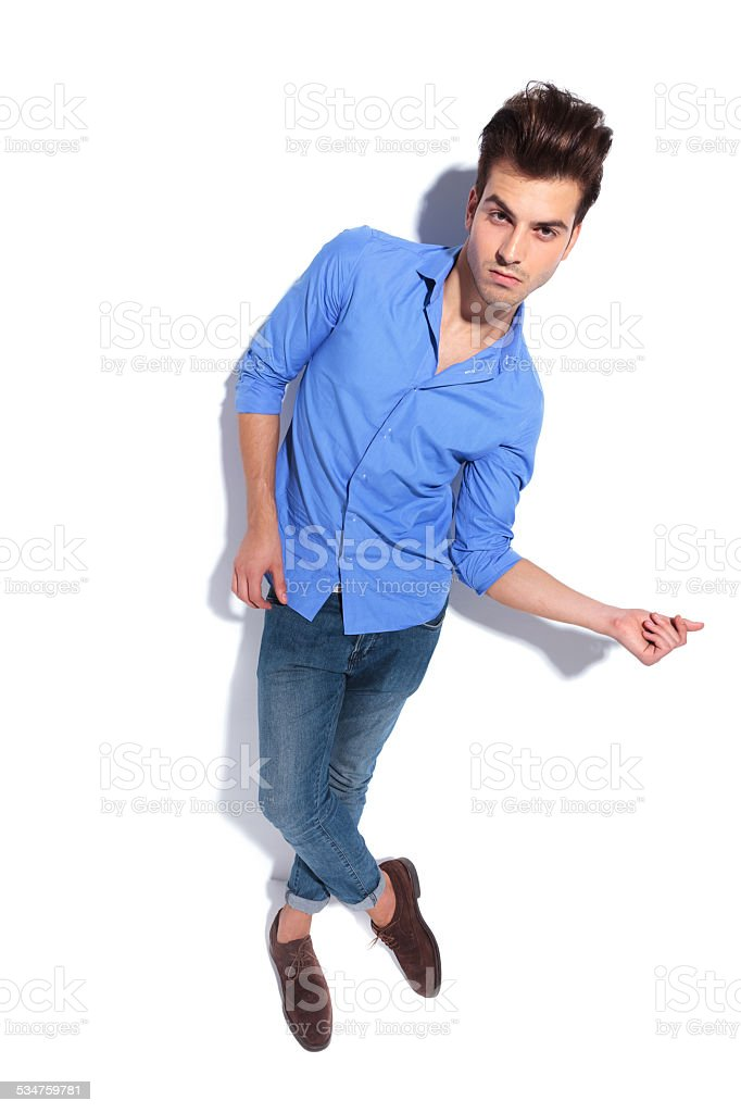 young fashion man snapping his fingers. stock photo
