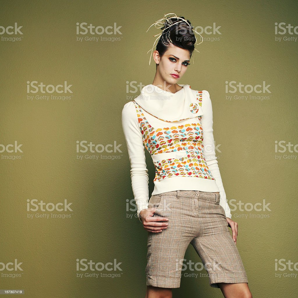 Young Fashion Model on Green Wall royalty-free stock photo