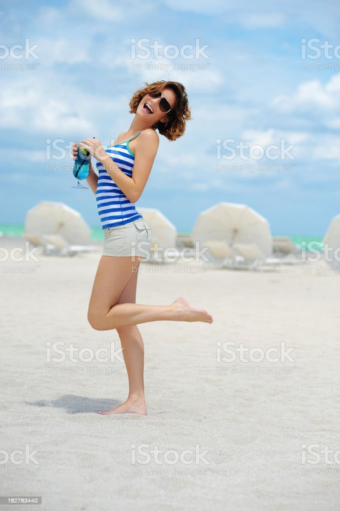 Young Fashion Model Woman with Cocktail on Beach royalty-free stock photo
