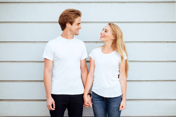 Young fashion stylish couple stand on streets of the city in summertime stock photo