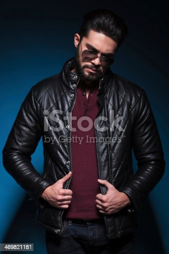istock young fashion unshaved man is looking sad 469821181