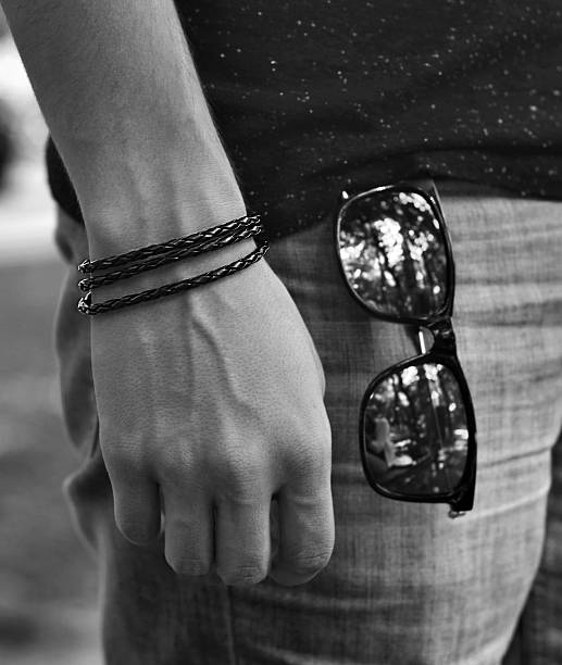 young fashion with glasses and bracelet - herren armband stock-fotos und bilder