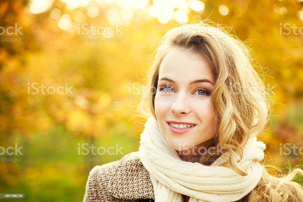 Young Fashion Woman on Autumn Background stock photo