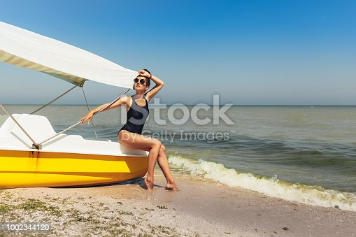 516818180 istock photo Young fashion woman relax on the beach. Happy island lifestyle. 1002344120