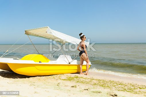 516818180 istock photo Young fashion woman relax on the beach. Happy island lifestyle. 961410958