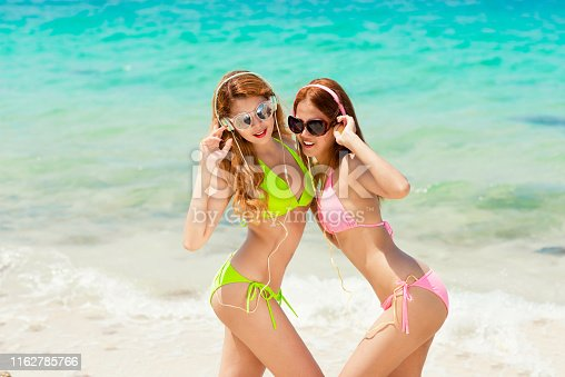 817409212 istock photo Young fashion woman relax on the beach. 1162785766